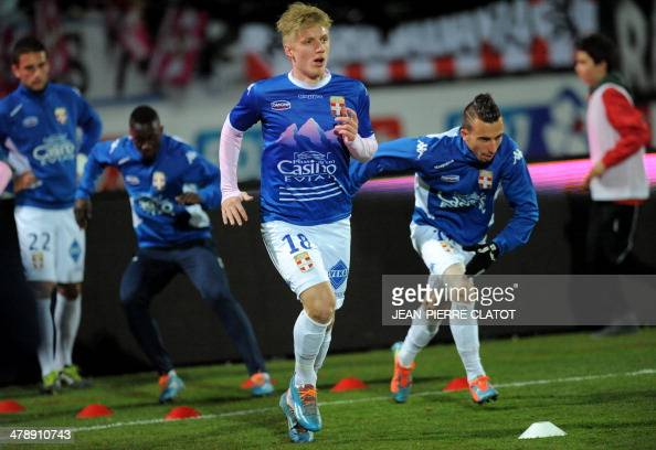Evian's Danish defender Daniel Wass warms up prior to the French L1 football match EvianThonon vs Valenciennes at the Parc des Sports in Annecy...