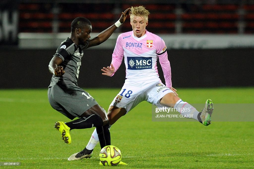 Evian's Danish midfielder Daniel Wass vies for the ball with Rennes' French Senegalese defender Fallou Diagne during the French L1 football match between Evian (ETGFC) and Rennes (SRFC) on January 10, 2015 at the Parc des Sports satdium in Annecy, central-eastern France.