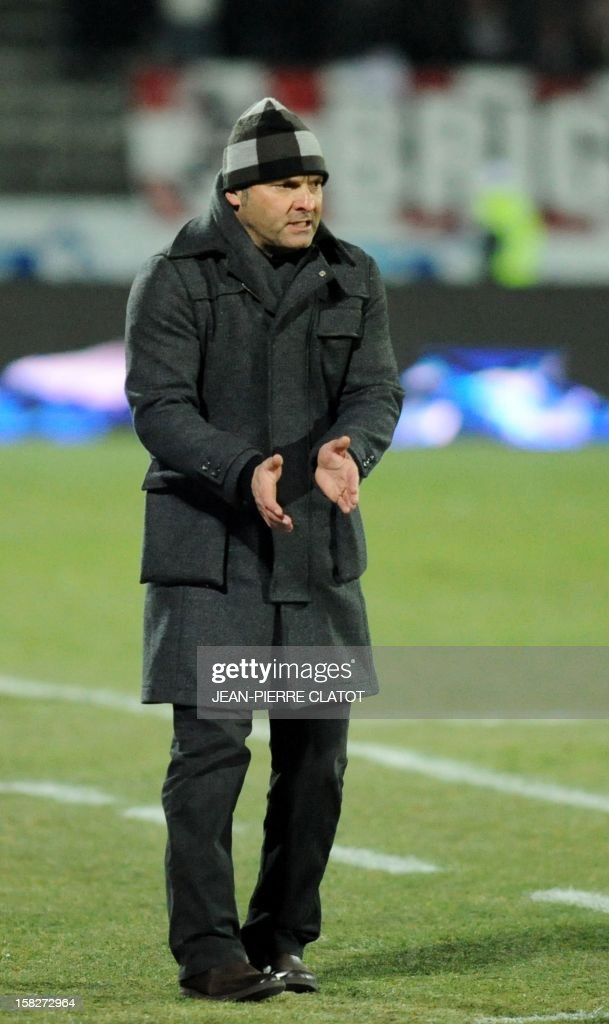 Evian's French coach Pascal Dupraz gestures during the French L1 football match Evian (ETGFC) vs Troyes (ESTAC) on December 12, 2012 at the Parc des Sports stadium in Annecy, eastern France.