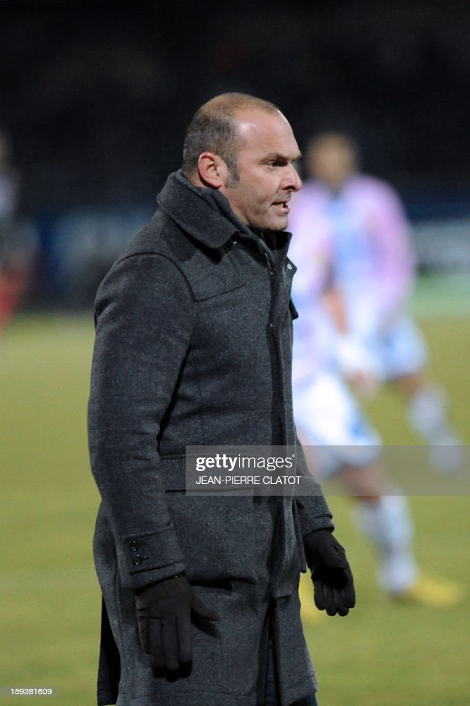Evian's French coach Pascal Dupraz looks on during the French L1 football match between Evian (ETGFC) and Brest (SB29) on January 12, 2013, at Parc des sports stadium in Annecy, eastern France.