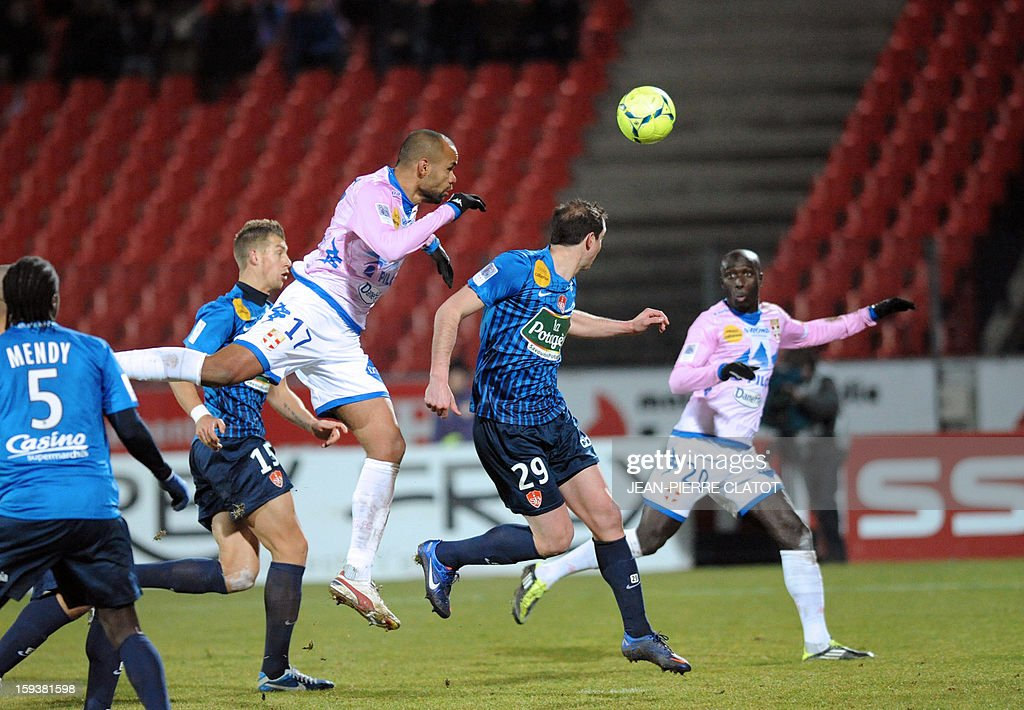 Evian's French defender Aldo Angoula (C) heads the ball during the French L1 football match between Evian (ETGFC) and Brest (SB29) on January 12, 2013, at Parc des sports stadium in Annecy, eastern France.