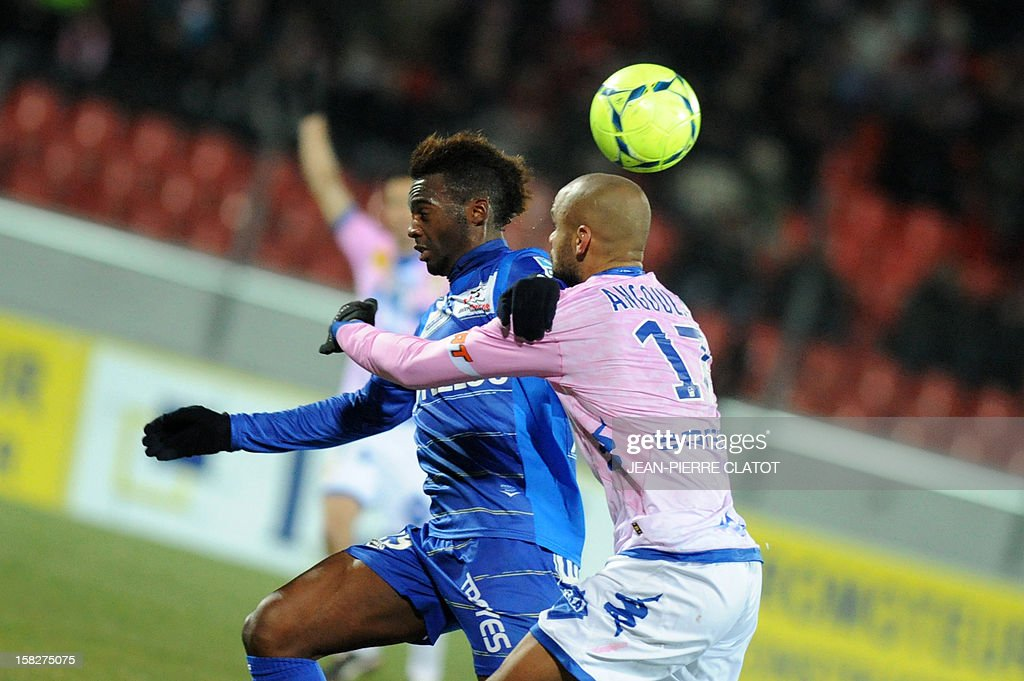 Evian's French defender Aldo Angoula (R) vies with Troyes' French forward Jean-Christophe Bahebeck during their French L1 football match Evian (ETGFC) vs Troyes (ESTAC), on December 12, 2012 on December 12, 2012 at the Parc des Sports stadium in Annecy, eastern France. AFP PHOTO / JEAN-PIERRE CLATOT