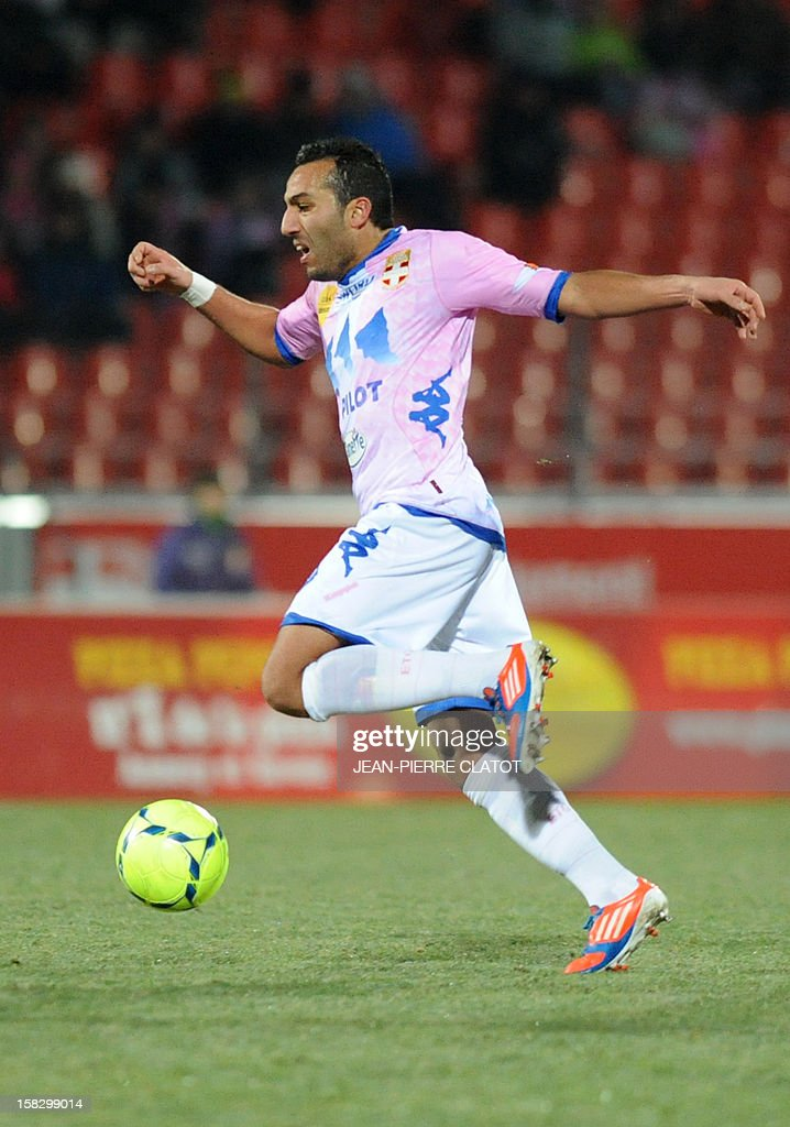 Evian's French forward Ali M'Madi runs with the ball during their French L1 football match Evian (ETGFC) vs Troyes (ESTAC) on December 12, 2012 at the city stadium Parc des sports in Annecy, eastern France. AFP PHOTO / JEAN-PIERRE CLATOT
