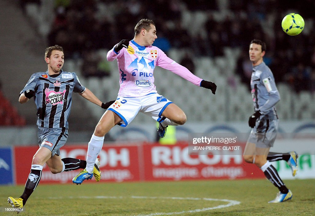 Evian's French forward Kevin Berigaud jumps to control the ball during the French L1 football match Evian (ETGFC) vs Ajaccio (ACA) on January 26, 2013 at the city stadium Parc des sports in Annecy, eastern France.