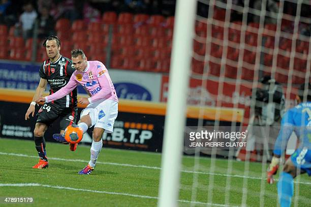 Evian's French forward Kevin Berigaud shoots during the French L1 football match EvianThonon vs Valenciennes at the Parc des Sports in Annecy central...