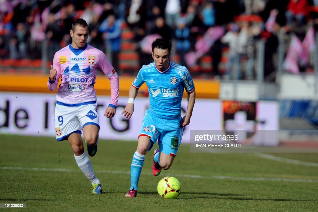 Evian's French forward Kevin Berigaud (L) vies with Marseille's French midfielder Mathieu Valbuena during the French L1 football match Evian (ETGFC) vs Marseille (OM) on February 10, 2013 at the city stadium Parc des sports in Annecy, eastern France.