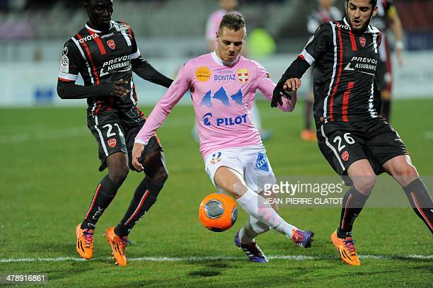 Evian's French forward Kevin Berigaud vies with Valenciennes' Senegalese defender Saliou Ciss and Valenciennes' French midfielder Marco Da Silva...