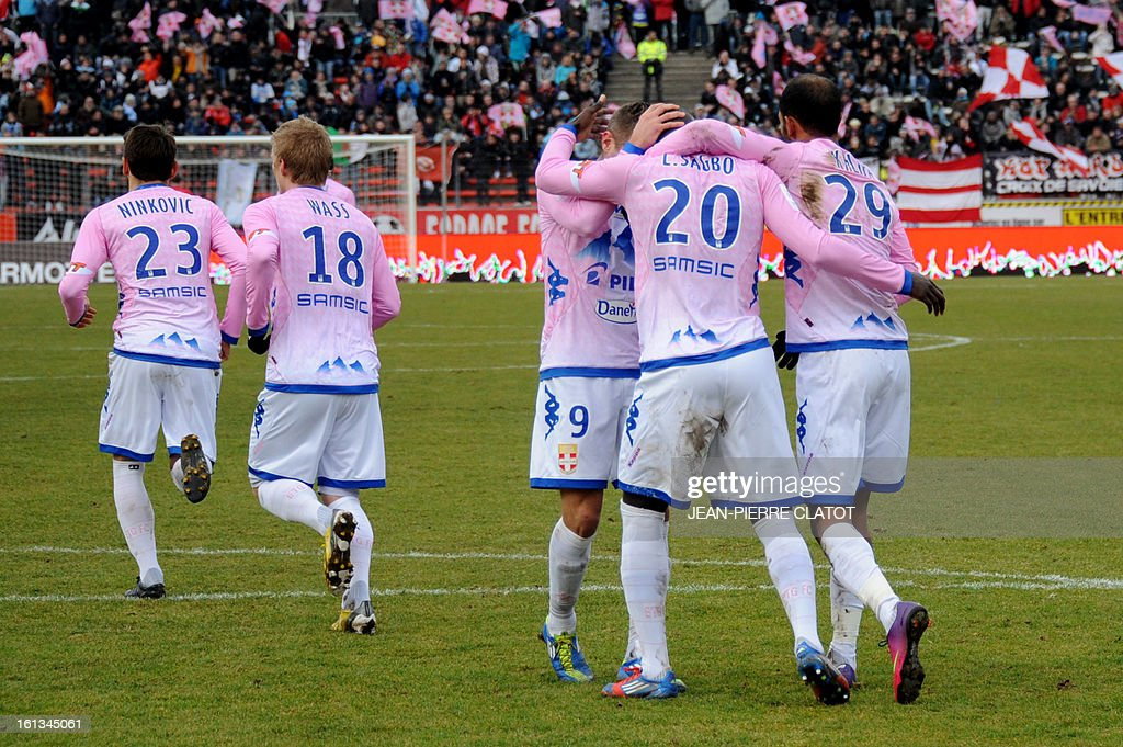 Evian's French forward Yannick Sagbo (2ndR) celebrates with teammates after scoring a goal during the French L1 football match Evian (ETGFC) vs Olympique de Marseille (OM) on February 10, 2013 at the city stadium Parc-des-sports in Annecy, eastern France.