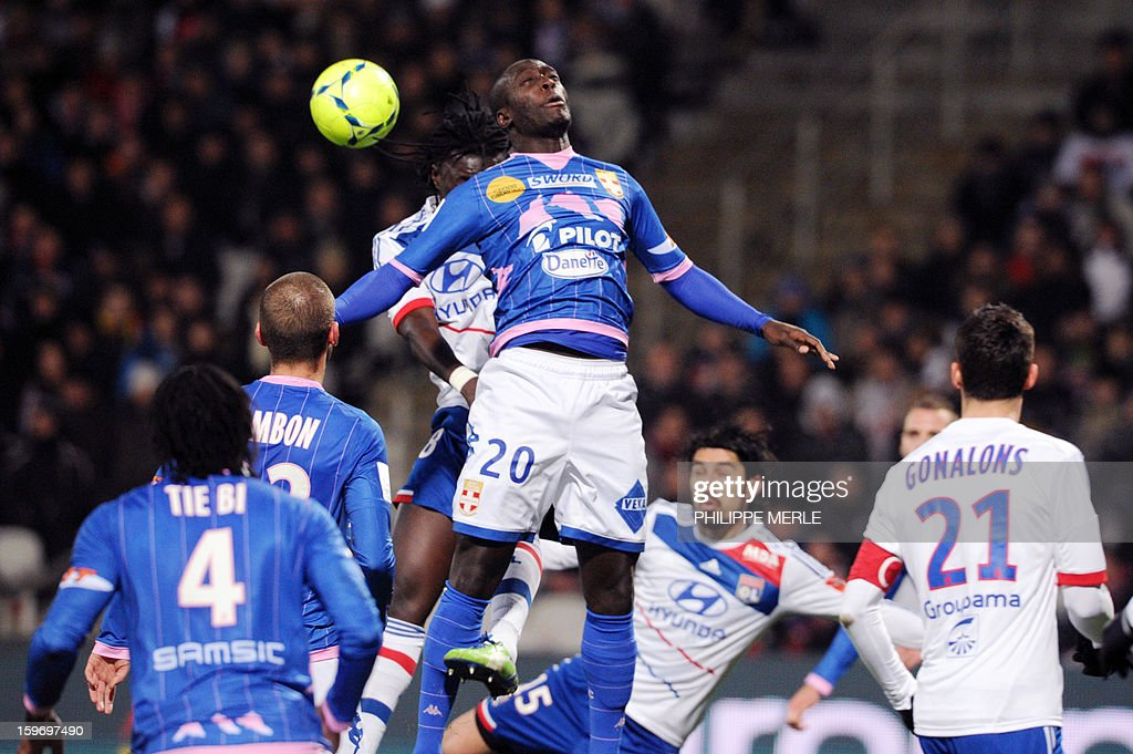 Evian's French forward Yannick Sagbo (C) head on during the French L1 football match Lyon (OL) vs Evian (ETG FC) on January 18, 2013 at the Gerland stadium in Lyon.