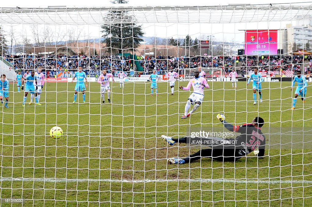 Evian's French forward Yannick Sagbo shoots ans scores a goal during the French L1 football match Evian (ETGFC) vs Olympique de Marseille (OM) on February 10, 2013 at the city stadium Parc-des-sports in Annecy, eastern France.
