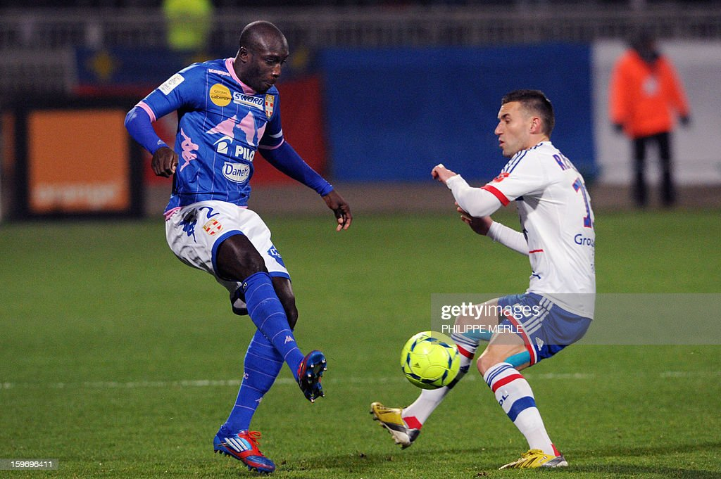 Evian's French forward Yannick Sagbo (L) vies with Lyon's French forward Anthony Reveillere during the French L1 football match Lyon (OL) vs Evian (TG) on January 18, 2013 at the Gerland stadium in Lyon.