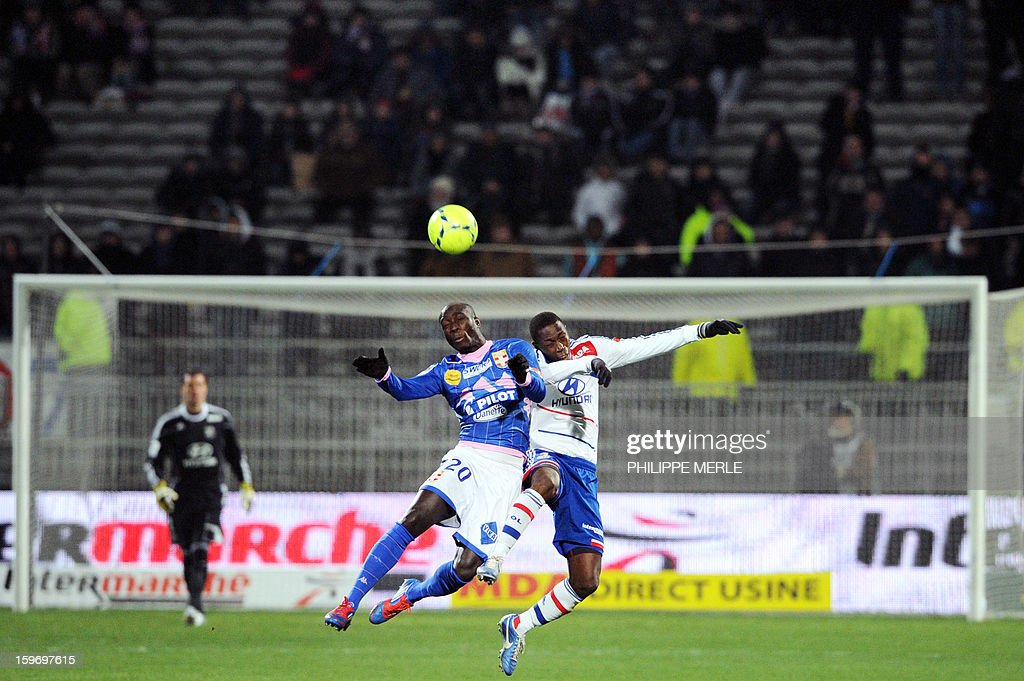 Evian's French forward Yannick Sagbo (C) vies with Lyon's Senegalese defender Mouhamadou Dabo (C,R) during the French L1 football match Lyon (OL) vs Evian (ETG FC) on January 18, 2013 at the Gerland stadium in Lyon.