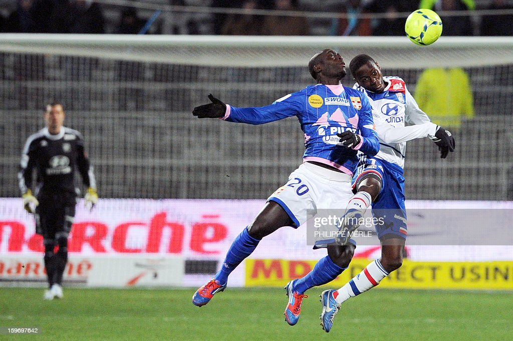 Evian's French forward Yannick Sagbo (C) vies with Lyon's Senegalese defender Mouhamadou Dabo (R) during the French L1 football match Lyon (OL) vs Evian (ETG FC) on January 18, 2013 at the Gerland stadium in Lyon. AFP PHOTO / PHILIPPE MERLE