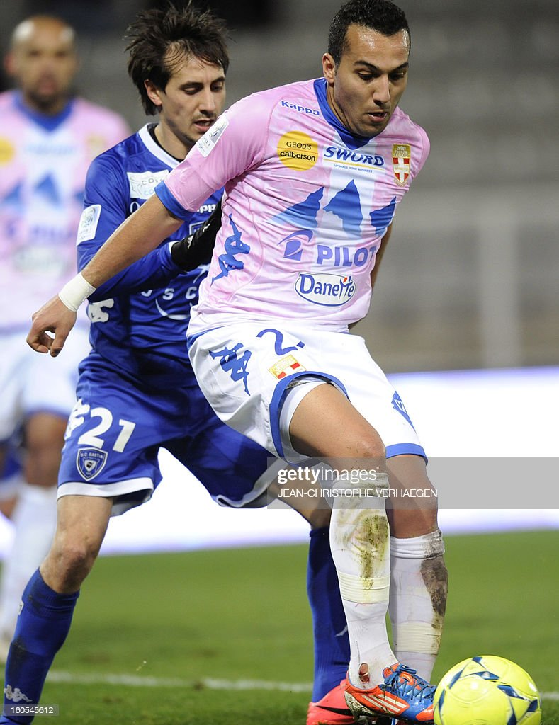 Evian's French forward Youssef Adnane fights for the ball with Bastia's Algerian defender Fethi Harek during the French L1 football match Bastia vs...