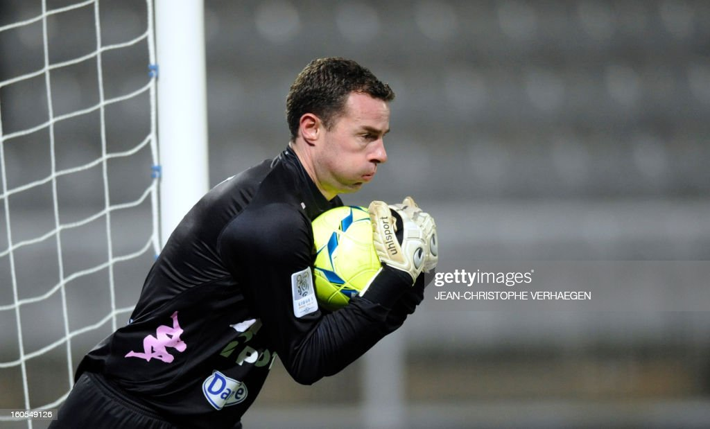 Evian's French goalkeeper Bertrand Laquait stops the ball during the French L1 football match Bastia (SCB) vs Evian (ETGFC) at the Abbe Deschamps Stadium, on February 2, 2013 in Auxerre.
