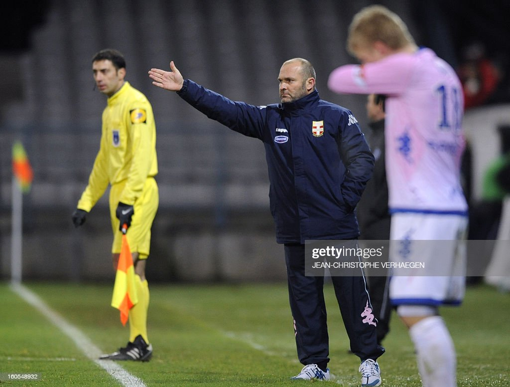 Evian's French head coach Jean-Yves Chay (C) reacts during the French L1 football match Bastia (SCB) vs Evian (ETGFC) at the Abbe Deschamps Stadium, on February 2, 2013 in Auxerre.
