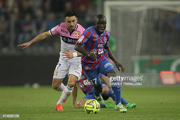 Evian's French midfielder Adrien Thomasson vies for the ball with Caen's French midfielder N'golo Kante during the French L1 football match between...