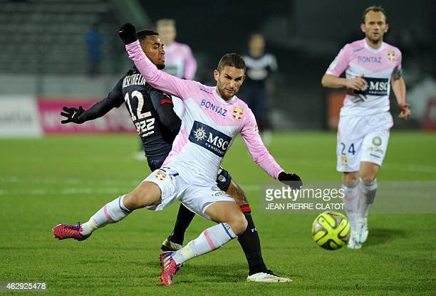 Evian's French midfielder Cédric Cambon vies with Bordeaux's French forward Hadi Sacko during the French L1 football match between Evian and Bordeaux...