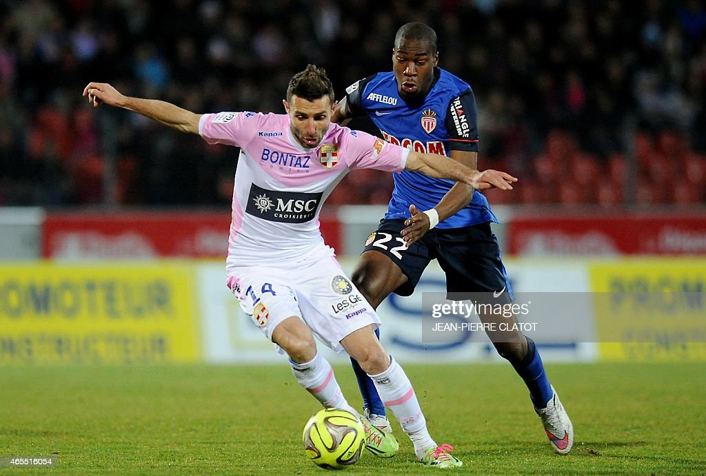 Evian's French midfielder Cedric Barbosa (L) challenges Monaco's French midfielder <a gi-track='captionPersonalityLinkClicked' href=/galleries/search?phrase=Geoffrey+Kondogbia&family=editorial&specificpeople=7552237 ng-click='$event.stopPropagation()'>Geoffrey Kondogbia</a> during the French L1 football match between Evian TG and Monaco at the Parc des Sports stadium in Annecy, southeastern France, on March 7, 2015. AFP PHOTO / JEAN-PIERRE CLATOT