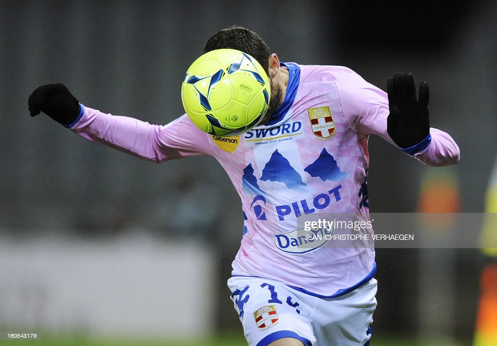 Evian's French midfielder Cedric Barbosa heads the ball during a French L1 football match between Bastia (SCB) and Evian (ETGFC) at the Abbe Deschamps Stadium on February 2, 2013 in Auxerre.