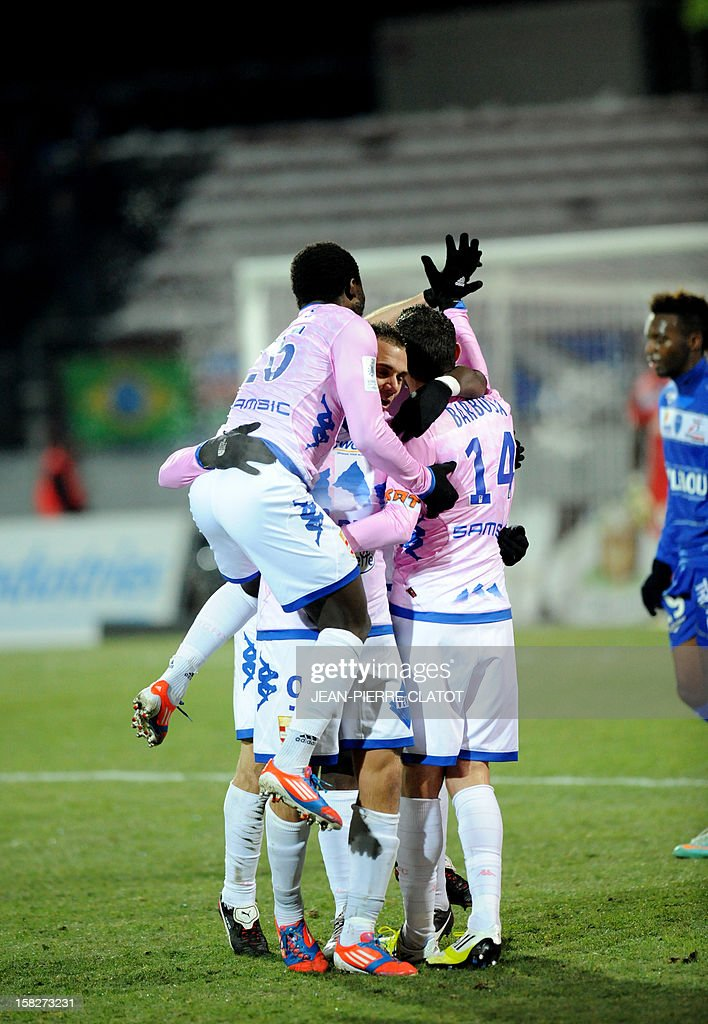 Evian's French midfielder Cedric Barbosa (C) is congratulated by his teammates after scoring a goal during their French L1 football match Evian (ETGFC) vs Troyes (ESTAC), on December 12, 2012 on December 12, 2012 at the Parc des Sports stadium in Annecy, eastern France.