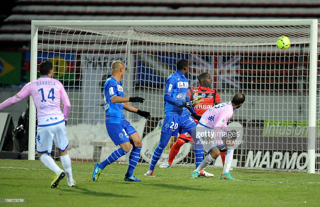 Evian's French midfielder Cedric Barbosa (L) shoots and scores a goal during a French L1 football match Evian (ETGFC) vs Troyes (ESTAC), on December 12, 2012 on December 12, 2012 at the Parc des Sports stadium in Annecy, eastern France.