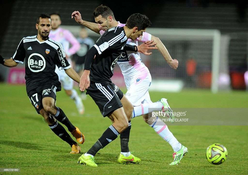 Evian's French midfielder Cedric Barbosa vies for the ball with Lorient's French defender <a gi-track='captionPersonalityLinkClicked' href=/galleries/search?phrase=Francois+Bellugou&family=editorial&specificpeople=5764271 ng-click='$event.stopPropagation()'>Francois Bellugou</a> during the French L1 football match Evian (ETGFC) against Lorient (FC) on March 4, 2015 at the stadium Parc des Sports in Annecy, southern France.