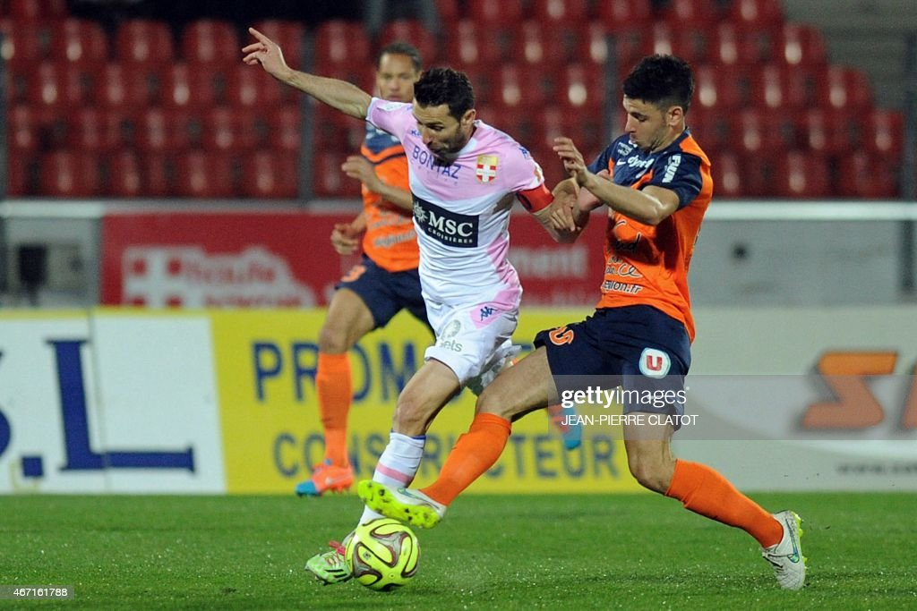 Evian's French midfielder Cedric Barbosa (C) vies with Montpellier's French midfielder <a gi-track='captionPersonalityLinkClicked' href=/galleries/search?phrase=Morgan+Sanson&family=editorial&specificpeople=10104687 ng-click='$event.stopPropagation()'>Morgan Sanson</a> (R) during the French L1 football match between Evian and Montpellier, on march 21, 2015 at the stadium Parc des Sports in Annecy, southern France. AFP PHOTO / JEAN-PIERRE CLATOT