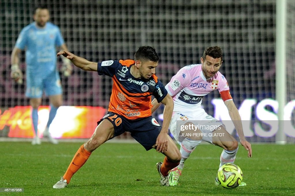Evian's French midfielder Cedric Barbosa (R) vies with Montpellier's French midfielder <a gi-track='captionPersonalityLinkClicked' href=/galleries/search?phrase=Morgan+Sanson&family=editorial&specificpeople=10104687 ng-click='$event.stopPropagation()'>Morgan Sanson</a> during the French L1 football match between Evian and Montpellier on march 21, 2015 at the Parc des Sports stadium in Annecy, southern, France. AFP PHOTO / JEAN-PIERRE CLATOT