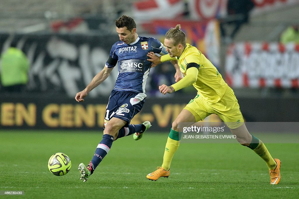 Evian's French midfielder Cedric Barbosa (L) vies with Nantes' Danish defender Kian Hansen during the French L1 football match between Nantes and Evian-Thonon-Gaillard (ETG) on March 14, 2015 at the Beaujoire stadium in Nantes, western France.