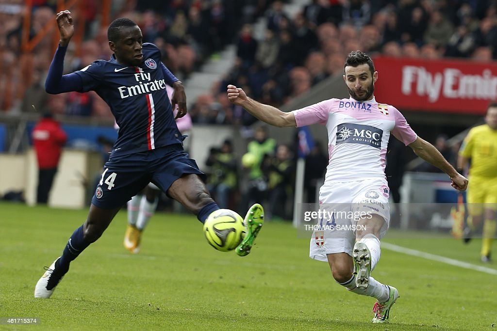 Evian's French midfielder Cedric Barbosa (R) vies with Paris Saint-Germain's French midfielder <a gi-track='captionPersonalityLinkClicked' href=/galleries/search?phrase=Blaise+Matuidi&family=editorial&specificpeople=801779 ng-click='$event.stopPropagation()'>Blaise Matuidi</a> during the French L1 football match between Paris Saint-Germain (PSG) and Evian (ETGFC) at the Parc des Princes stadium, in Paris, on January 18, 2015. AFP PHOTO / THOMAS SAMSON