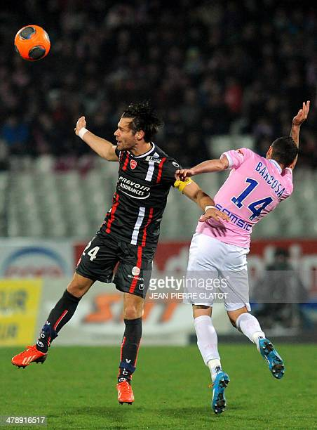 Evian's French midfielder Cedric Barbosa vies with Valenciennes' Uruguayan defender Gary Kagelmacher during the French L1 football match EvianThonon...