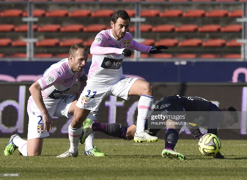 Evian's French midfielder <a gi-track='captionPersonalityLinkClicked' href=/galleries/search?phrase=Fabien+Camus&family=editorial&specificpeople=5702744 ng-click='$event.stopPropagation()'>Fabien Camus</a> (C) and Evian's French midfielder Olivier Sorlin (L) vies with Toulouse's French Moroccan midfilder Adrien Regattin (R) during the French L1 football match Evian Thonon Gaillard against Toulouse FC on January 25, 2015 at the Parc des Sports stadium in Annecy, Eastern France. AFP PHOTO/PHILIPPE DESMAZES
