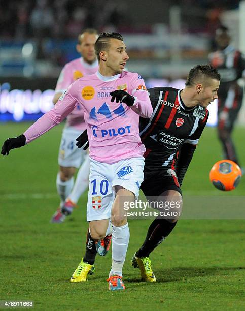 Evian's French midfielder Nicolas Benezet vies with Valenciennes' French defender Loris Nery during the French L1 football match EvianThonon vs...