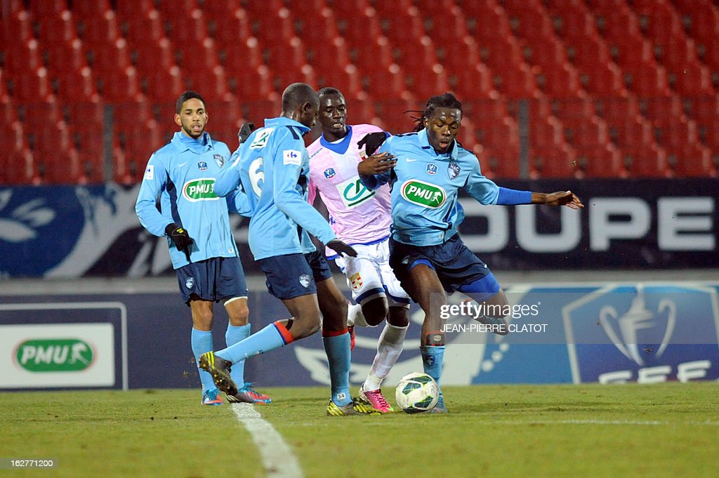 Evian's Ghanaian midfielder Mohammed Rabiu (2ndR) vies with Le Havre's French defender Elhadji Ba (2ndL) during a French Cup football match Evian (ETGFC) vs Le Havre (HAC) on February 26, 2013 at the Parc des Sports city stadium in Annecy, eastern France.