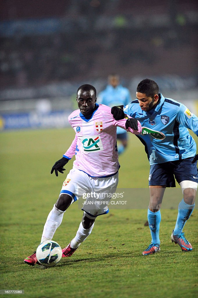 Evian's Ghanaian midfielder Mohammed Rabiu (L) vies with Le Havre's French defender Jerome Mombris during a French Cup football match Evian (ETGFC) vs Le Havre (HAC) on February 26, 2013 at the Parc des Sports city stadium in Annecy, eastern France.
