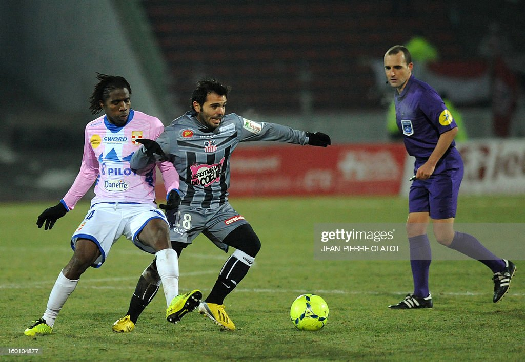 Evian's Ivoirian midfielder Eric Tie Bi (L) vies with Ajaccio's French midfielder Johan Cavalli during their French L1 football match Evian (ETGFC) vs Ajaccio (ACA), on January 26, 2013, at the city stadium Parc des sports in Annecy, eastern France.