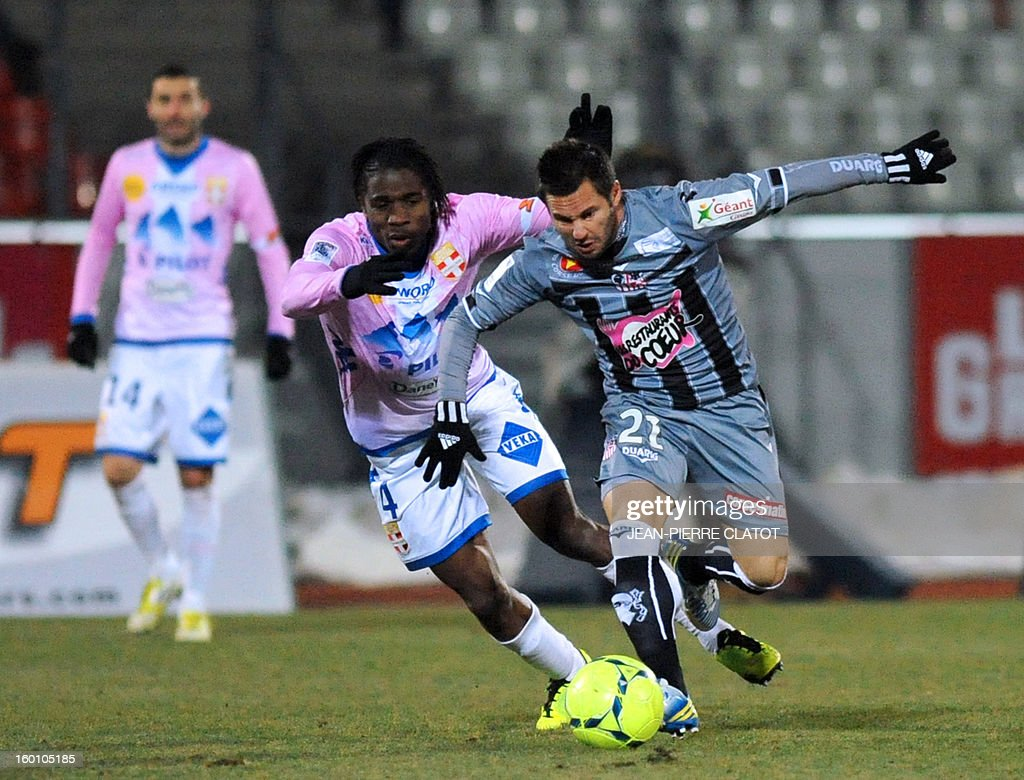 Evian's Ivoirian midfielder Eric Tie Bi (L) vies with Ajaccio's French midfielder Frederic Sammaritano during the French L1 football match Evian (ETGFC) vs Ajaccio (ACA) on January 26, 2013 at the city stadium Parc des sports in Annecy, eastern France.