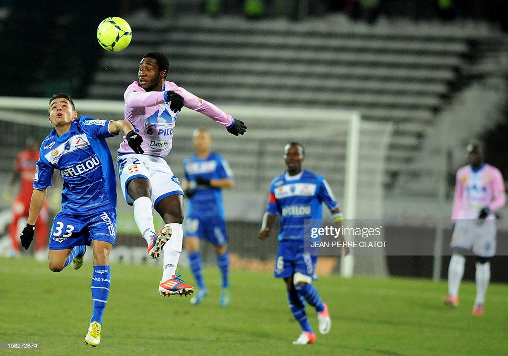 Evian's Ivorian defender Brice Dja DjeDje (2nd L) jumps for the ball with Troyes' French midfielder Corentin Jean (L) during the French L1 football match Evian (ETGFC) vs Troyes (ESTAC) on December 12, 2012 at the Parc des Sports stadium in Annecy, eastern France.