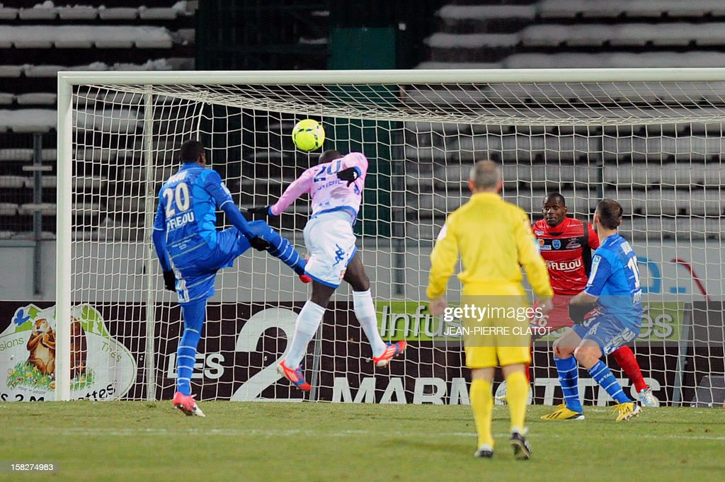 Evian's Ivorian forward Yannick Sagbo (2ndL) heads the ball during a French L1 football match Evian (ETGFC) vs Troyes (ESTAC), on December 12, 2012 on December 12, 2012 at the Parc des Sports stadium in Annecy, eastern France.