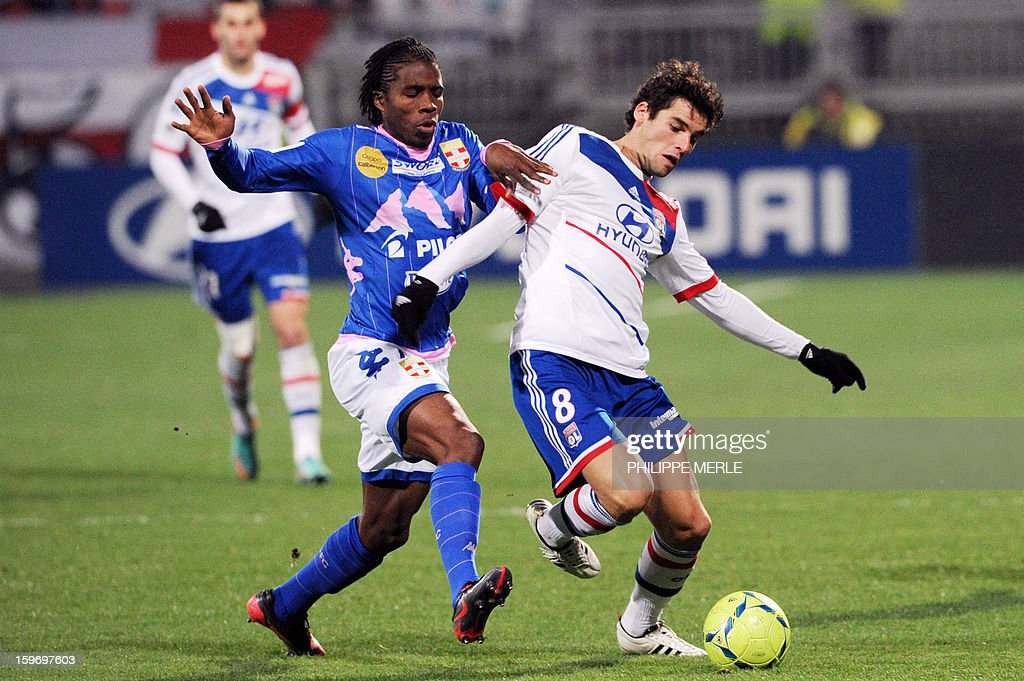 Evian's Ivorian midfielder Eric Tie Bi (C) vies with Lyon's French midfielder Yoann Gourcuff (R) during the French L1 football match Lyon (OL) vs Evian (ETG FC) on January 18, 2013 at the Gerland stadium in Lyon.