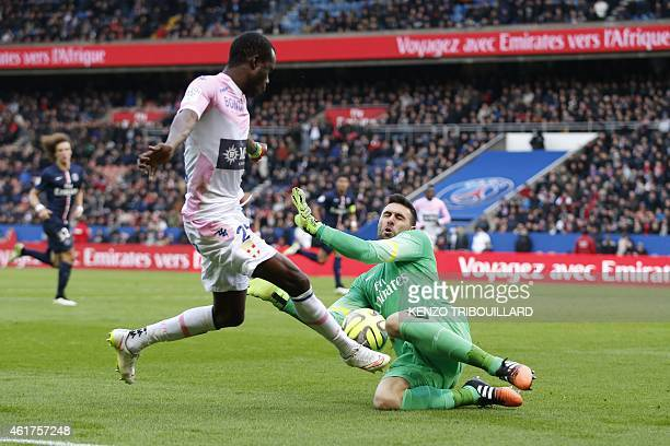 Evian's Senegalese midfielder Modou Sougou vies with Paris SaintGermain's Italian goalkeeper Salvatore Sirigu during the French L1 football match...