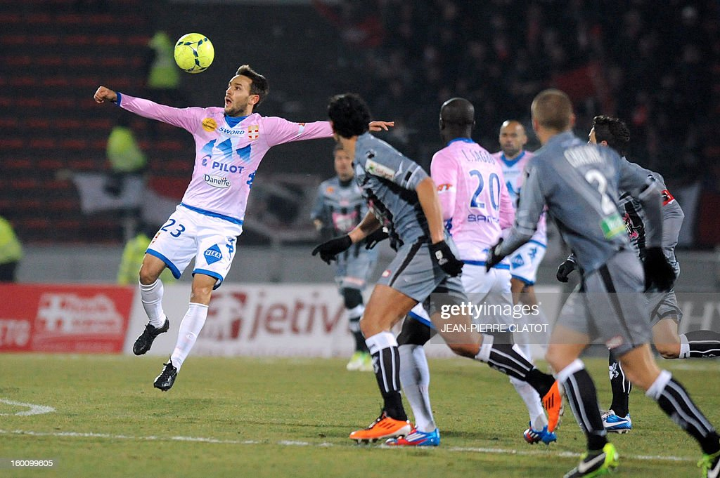 Evian's Serbian midfielder Milos Ninkovic jump to control the ball during the French L1 football match Evian (ETGFC) vs Ajaccio (ACA) on January 26, 2013 at the city stadium Parc des sports in Annecy, eastern France.