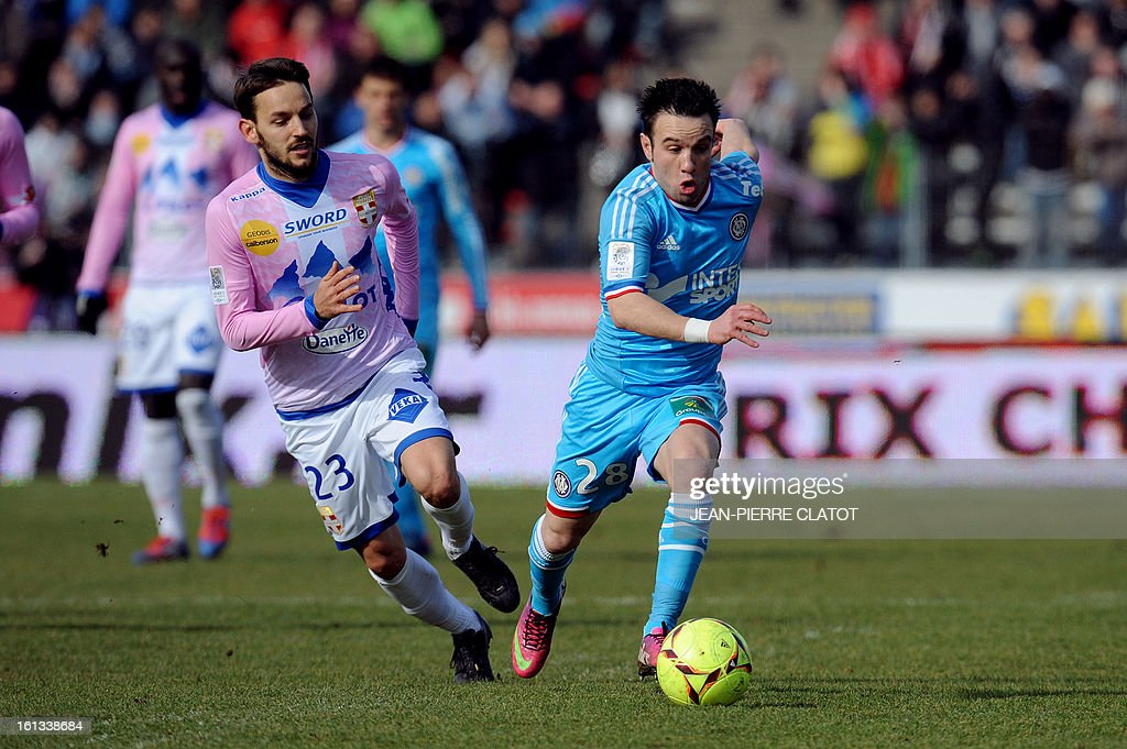 Evian's Serbian midfielder Milos Ninkovic (L) vies with Marseille's French midfielder Mathieu Valbuena during the French L1 football match Evian (ETGFC) vs Marseille (OM) on February 10, 2013 at the city stadium Parc des sports in Annecy, eastern France.