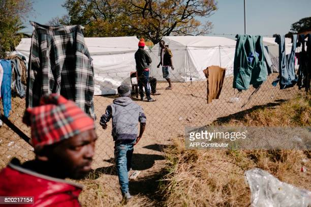 TOPSHOT Evicted resident of the Fattis Mansion building arrive at the new temporary camp in Turffontein on July 21 2017 Residents of allegedly...