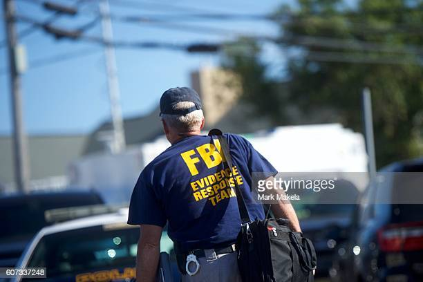 FBI evidence response team agent arrives near the scene of an 'pipe bombstyle device' explosion on September 17 2016 in Seaside Park New Jersey The...