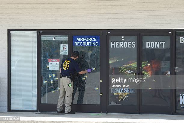 Evidence Response Team Members gather information at Armed Forces Career Center/National Guard Recruitment Office on July 17 2015 in Chattanooga...