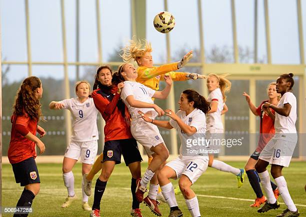 Evie Clarke of England challenges Hildegunn Saevik of Norway during the U19 Women's Friendly match between England U19 Women and Norway U19 Women at...