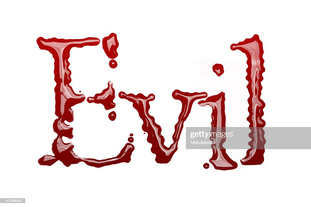 Evil written in blood : Stock Photo