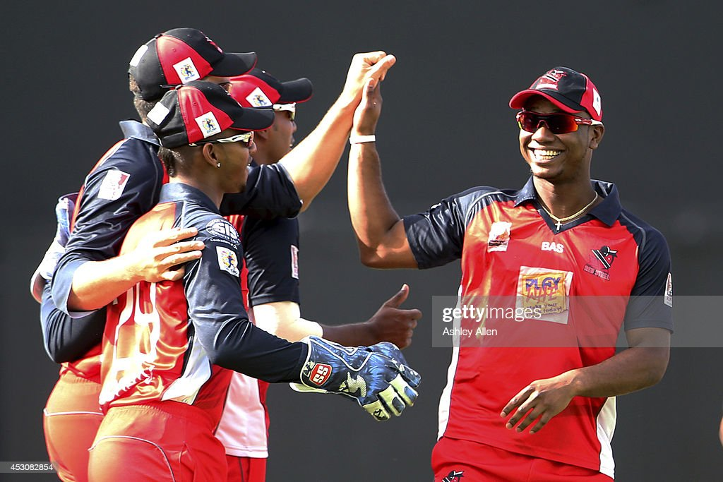 Evin Lewis (R) celebrates with his team mates during a match between St. Lucia Zouks and The Trinidad and Tobago Red Steel as part of week 4 of the Limacol Caribbean Premier League 2014 at Beausejour Stadium on August 02, 2014 in Castries, St. Lucia.